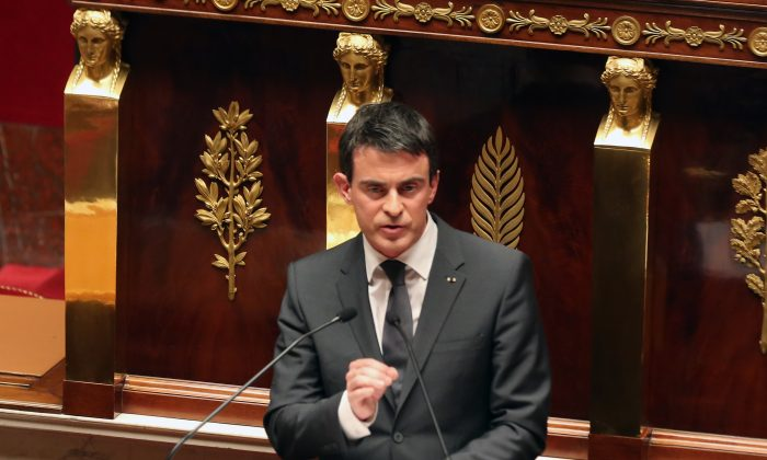 French prime minister Manuel Valls delivers his speech during an homage to the 17 victims of last week terrorist attacks, at the French national Assembly in Paris, Tuesday Jan. 13, 2015. (AP Photo/Remy de la Mauviniere)