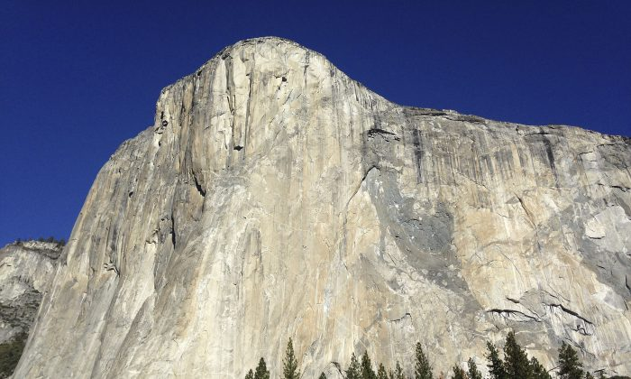 Shown is El Capitan where two climbers vying to become the first in the world to use only their hands and feet to scale a sheer slab of granite make their way to the summit Wednesday, Jan. 14, 2015, in Yosemite National Park, Calif. The pair are closing in on the top of the 3,000-foot peak and if all goes as planned, 30-year-old Kevin Jorgeson of California and 36-year-old Tommy Caldwell of Colorado, should complete their climb early Wednesday afternoon. (AP Photo/Ben Margot)