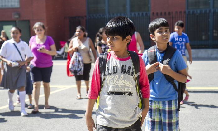 Boys at P.S. 234 after their first day of school in Astoria, New York, Sept. 4, 2014. (Samira Bouaou/Epoch Times)