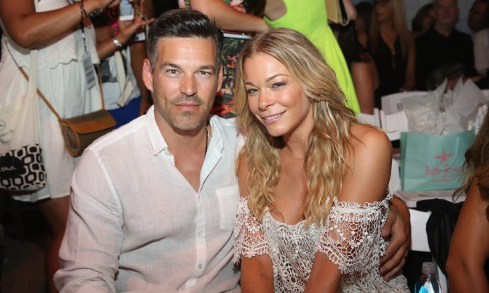 Eddie Cibrian and LeAnn Rimes attend Luli Fama fashion show during Mercedes-Benz Fashion Week Swim 2015 at Cabana Grande at The Raleigh on July 20, 2014 in Miami, Florida. (Photo by Aaron Davidson/Getty Images for Luli Fama)