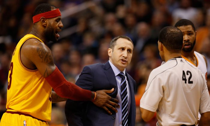 ead coach David Blatt of the Cleveland Cavaliers reacts to referee Eric Lewis #42 as LeBron James #23 holds him back during the second half of the NBA game against the Phoenix Suns at US Airways Center on January 13, 2015 in Phoenix, Arizona. (Photo by Christian Petersen/Getty Images)