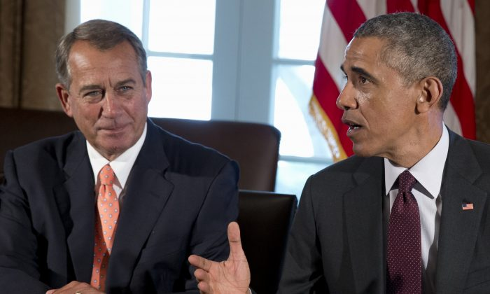 House Speaker John Boehner of Ohio listens at left as President Barack Obama speaks to media as he meets with bipartisan, bicameral leadership of Congress to discuss a wide range of issues, in the Cabinet Room of the White House in Washington on Jan. 13, 201. President Barack Obama has vetoed just two measures in his six years in the White House, the fewest by any US president since the 1880s. But since the Republicans have assumed control of both houses of Congress this month for the first time in his presidency, Obama has threatened to veto five more. (AP Photo/Carolyn Kaster)
