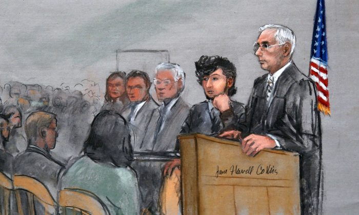 In this courtroom sketch, Boston Marathon bombing suspect Dzhokhar Tsarnaev, (2nd R), is with his lawyers and U.S. District Judge George O'Toole Jr. (AP Photo/Jane Flavell Collins)