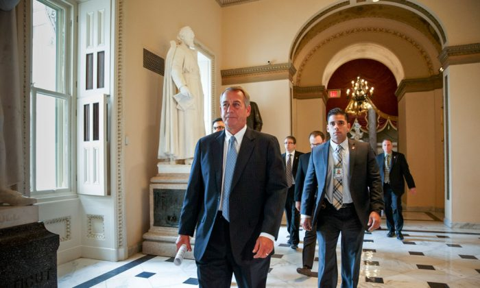 House Speaker John Boehner of Ohio, accompanied by a U.S. Capitol Police officer (R), walks to the House chamber on Capitol Hill in Washington, Wednesday, Jan. 14, 2015, as lawmakers gather for a vote to fund the Homeland Security Department but will curb President Barack Obama's executive actions on immigration. An Ohio bartender with a history of psychiatric illness was indicted on a charge of threatening to murder Boehner, possibly by poisoning his drink at a country club or shooting him, according to court documents. A grand jury indictment filed in U.S. District Court in Ohio on Jan. 7 identified the accused man as Cincinnati resident Michael R. Hoyt, said the records made available Tuesday. (AP Photo/J. Scott Applewhite)