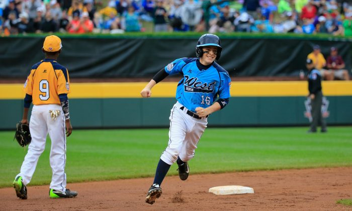 Brad Stone 16 of the West Team from Las Vegas rounds the bases after hitting a home run against the Great Lakes Team from Chicago during the United States Championship game of the Little League World Series in South Williamsport, Pa., on Aug. 23, 2014. (Rob Carr/Getty Images)
