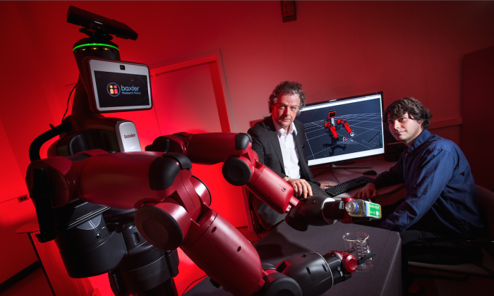 University of Maryland computer scientist Yiannis Aloimonos (center) is developing robotic systems able to visually recognize objects and generate new behavior based on those observations. (John T. Consoli/University of Maryland)