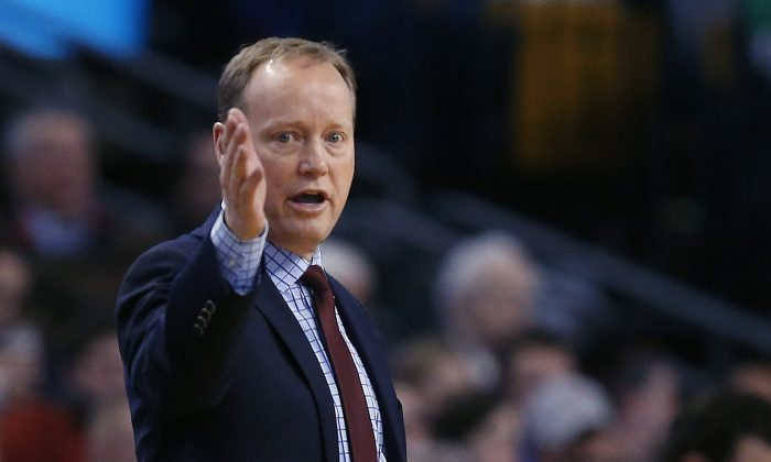 Atlanta Hawks head coach Mike Budenholzer gestures during the first half of an NBA basketball game against the Boston Celtics in Boston, Wednesday, Jan. 14, 2015. (AP Photo/Elise Amendola)