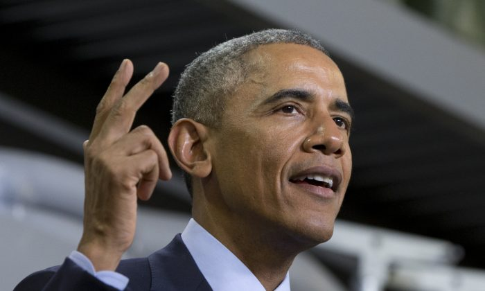 President Barack Obama speaks at Cedar Falls Utilities in Cedar Falls, Iowa, Wednesday, Jan. 14, 2015, about steps to increase access to affordable, high-speed broadband across the country. (AP Photo/Carolyn Kaster)