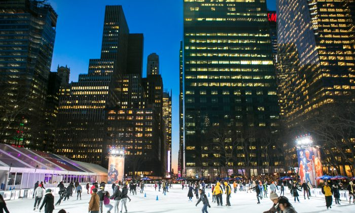 People ice skate at Bryant Park on Jan. 13, 2015 in New York, which will be open to the public for free until March. 1. (Benjamin Chasteen/Epoch Times)