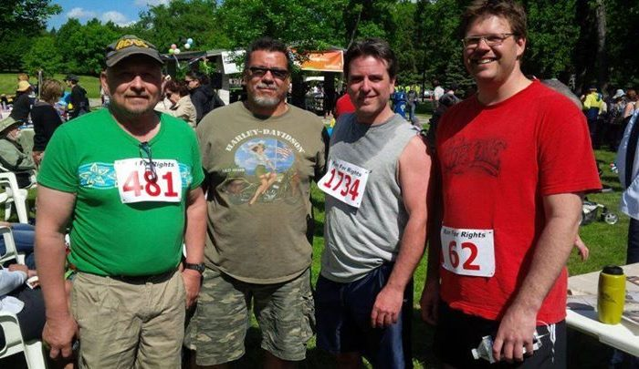 Brad Franck (2nd R) poses with three other members of Better Fathers on June 7, 2014, after completing Run for Rights, an annual event in support of Winnipeg organizations working for social justice and human rights. (Better Fathers Inc.)