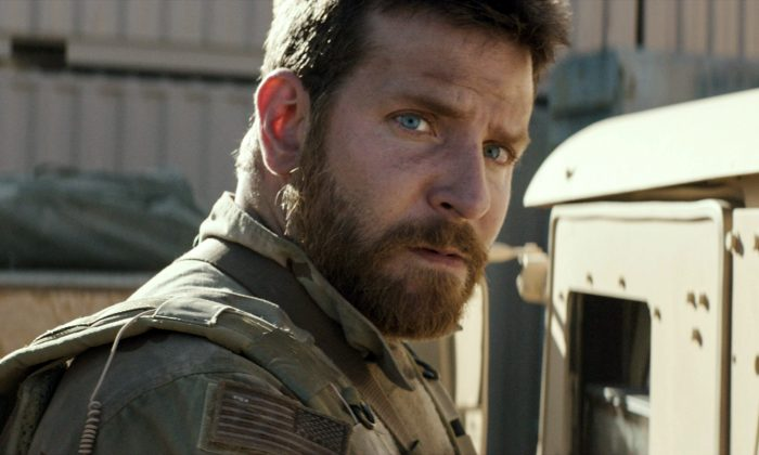 "Bradley Cooper playing the role of Chis Kyle in  ""American Sniper."" The film grabbed $64 million at the box office this weekend for a total of $200 million domestic at the box office. (AP Photo/Warner Bros. Pictures)"