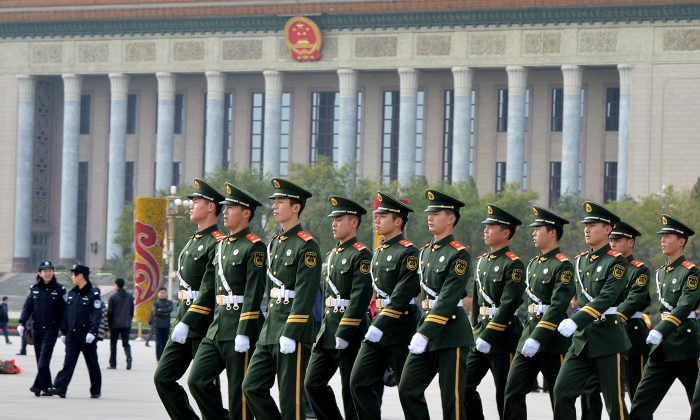In this file photo paramilitary police march through Tiananmen Square in Beijing on Nov. 7, 2012. (Mark Ralston/AFP/Getty Images)