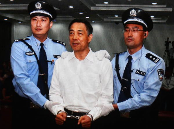 Former Chinese Politburo member Bo Xilai (C) on Sept. 22, 2013, in handcuffs in Beijing, China. Bo plotted with Zhou Yongkang, the former security boss, according to recent reports. (Feng Li/Getty Images)