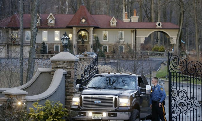 """A police officer talks with the driver of a truck carrying children from the home of Teresa Giudice, a cast member of Bravo's """"Real Housewives of New Jersey,"""" and her husband Giuseppe """"Joe"""" Giudice Monday, Jan. 5, 2015, in the Towaco section of Montville Township, N.J. Teresa Giudice is scheduled to report to a federal prison in Danbury, Connecticut, on Monday morning to begin serving a 15-month sentence for bankruptcy fraud. U.S. District Judge Esther Salas staggered her sentence with her husband's so they wouldn't be in prison at the same time and unable to care for their four daughters.  She and her husband pleaded guilty last year and admitted hiding assets from bankruptcy creditors and submitting phony loan applications to get some $5 million in mortgages and construction loans. (AP Photo/Mel Evans)"""