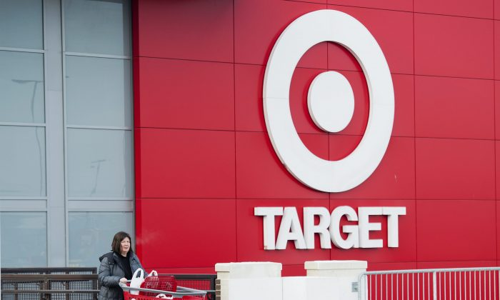 Shopper Laura Steele leaves a Target store in Toronto on Thursday, Jan. 15, 2015. More than 17,600 Target employees will eventually lose their jobs when the U.S. discount retailer closes its 133 Canadian stores after only about two years to end financial losses that went as high as a billion dollars a year. (AP Photo/The Canadian Press, Nathan Denette)