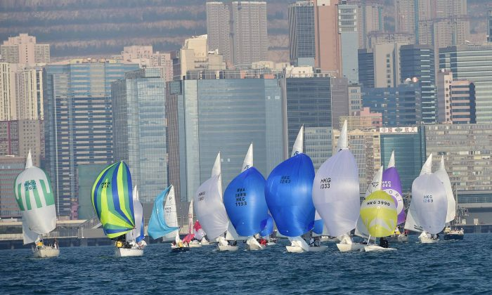 Boats of different classes, sailing down-wind to the Kowloon Bay Mark during the RHKYC Tomes Cup event on Saturday Jan 10, 2015. (Bill Cox/Epoch Times)