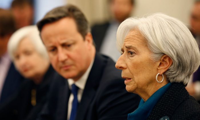 Federal Reserve Chair Janet Yellen (L) listens with British Prime Minister David Cameron, as International Monetary Fund (IMF) Managing Director Christine Lagarde, speaks during a round table meeting at the IMF, Thursday, Jan. 15, 2015 in Washington. (AP Photo/Alex Brandon)