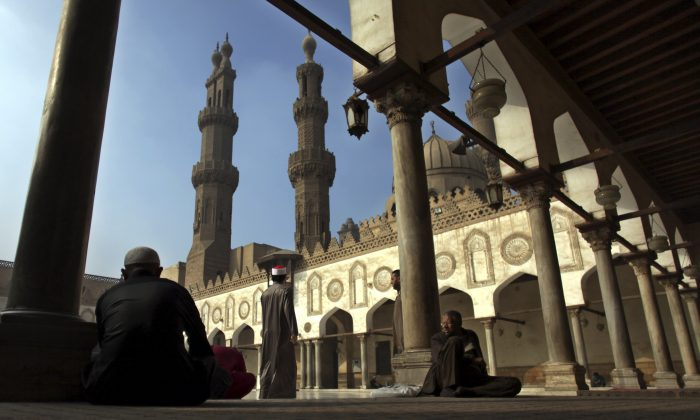 "Muslims rest as they wait for the Friday noon prayer at Al-Azhar mosque in Cairo on Dec. 28, 2012. Egyptian President Abdel-Fattah el-Sissi opened 2015 with a dramatic call for a ""revolution"" in Islam. His professed goal is to purge the religion of extremist ideas of intolerance and violence that fuel groups like al-Qaeda and the Islamic State. To enact change, he i's relying on state religious institutions, like the 1,000-year-old al-Azhar, one of the most imminent centers of Sunni Muslim thought. Shifting al-Azhar and other calcified institutions to rethink basic tenets and make them more appealing to young people in a modern age is difficult. (AP Photo/Khalil Hamra)"