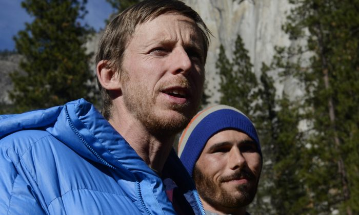 Climbers Tommy Caldwell (L) and Kevin Jorgeson (R) speak during a press conference in Yosemite Valley near the base of El Capitan Thursday morning, Jan. 15, 2015, in Yosemite National Park, Calif. The two Americans became the first to free-climb El Capitan's Dawn Wall. They used ropes and safety harnesses in case of a fall but relied only on their hands, feet and strength to reach the 3,000-foot summit the day before. The trek began Dec. 27. (AP Photo/The Fresno Bee, Eric Paul Zamora)