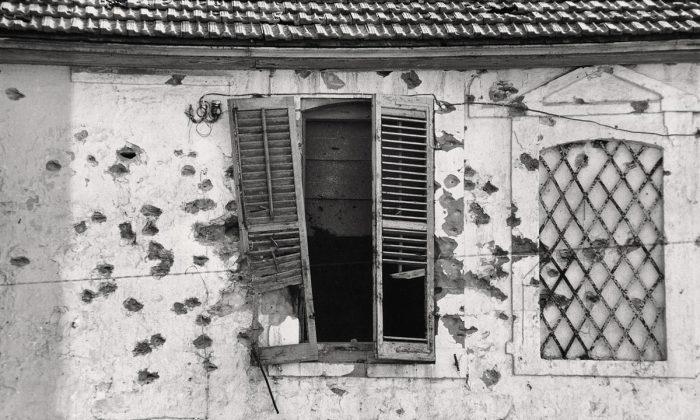 Bullet holes in a façade, Cyprus, 1974. (Jean Mohr/Musée de l'Elysée)