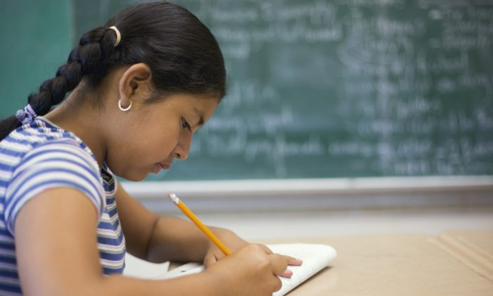 In a study on children's report cards and sleep, greater sleep efficiency was associated with better math and language grades, but grades in science and art weren't affected. (Creatas/Creatas/Thinkstock)