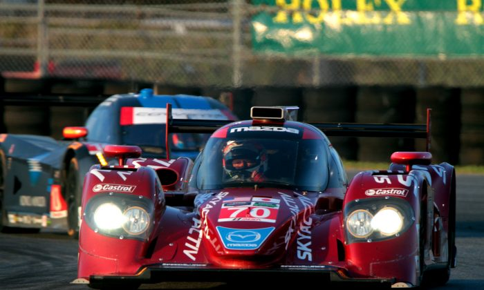 The #70 Mazda diesel leads the #10 WTR Dallara-Corvette through the East Horseshoe at Daytona International Speedway during the Tudor Championship Roar Before the 24, Jan. 10, 2015. (Chris Jasurek/Epoch Tiimes)