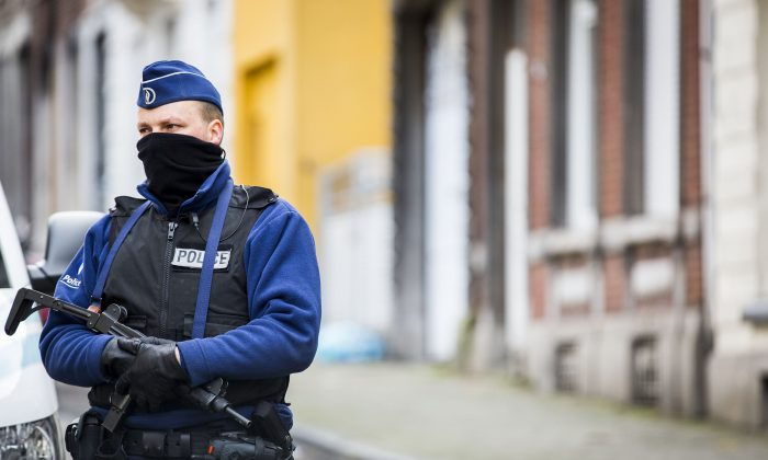 An armed Belgian police officer patrols Colline Street in Verviers, eastern Belgium, on Jan. 16, 2015 one day after two suspected jihadists were killed in a police raid. (Valerie Kuypers/AFP/Getty Images)
