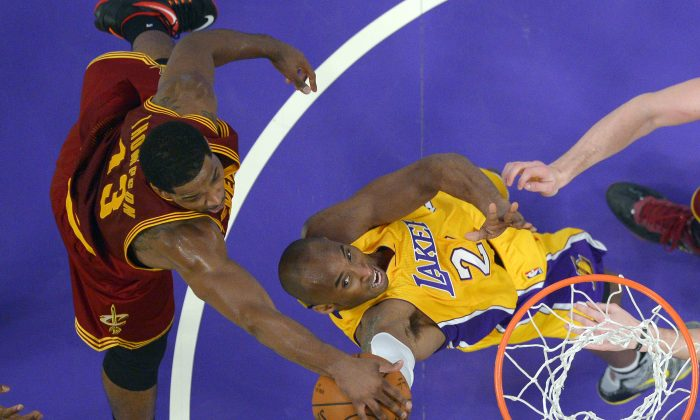 Los Angeles Lakers guard Kobe Bryant, right, has his shot blocked by Cleveland Cavaliers center Tristan Thompson during the first half of an NBA basketball game, Thursday, Jan. 15, 2015, in Los Angeles. (AP Photo/Mark J. Terrill)