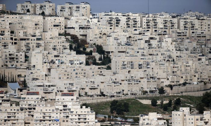 A partial view taken on Dec. 18, 2014, shows the east Jerusalem Israeli settlement of Har Homa from the West Bank city of Bethlehem, which was originally built in the 1990s, in the annexed Arab east Jerusalem area of Jabal Abu Ghneim. (Thomas Coex/AFP/Getty Images)