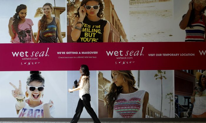 Shianne Penoli walks past the future location of Wet Seal at the Mount Shasta Mall in Redding, Calif., on July 2, 2013. Wet Seal, a teen clothing retailer, has filed for Chapter 11 bankruptcy protection, the company announced Friday, Jan. 16, 2015. (AP Photo/Record Searchlight, Greg Barnette)