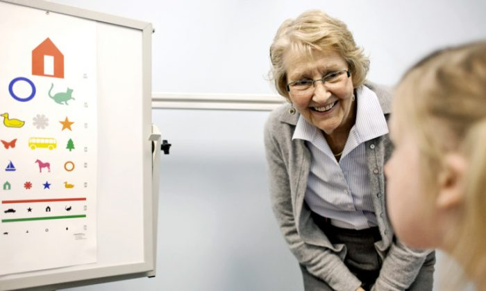 Judith Miles and a patient. (Rebecca F. Miller/U. Missouri)