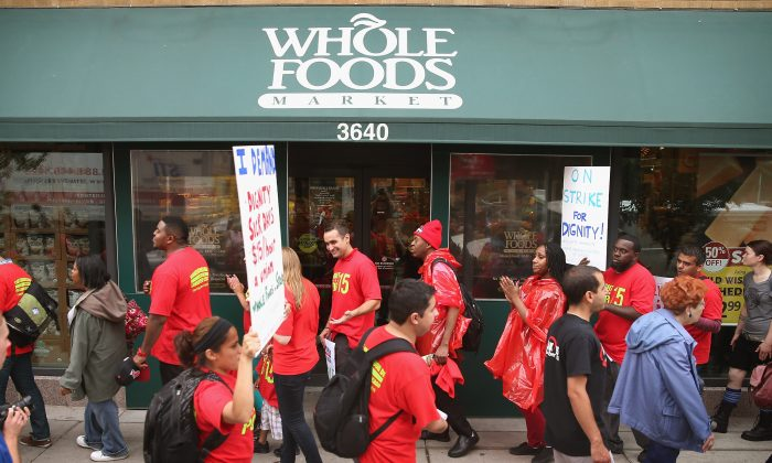 In 2013 Whole Foods Market employees and union activists went on strike    calling for workers to be paid at least $15-per-hour and have the right to form unions without retaliation. (Scott Olson/Getty Images)