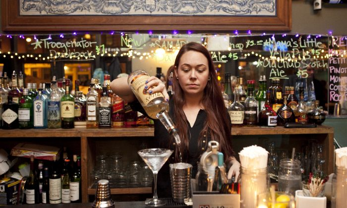 Bartender Nichole Osbourne makes a drink at Meade's Pub located at South Street Seaport on Feb. 19, 2014. The pub was forced to close due to rent increase. (Samira Bouaou/Epoch Times)