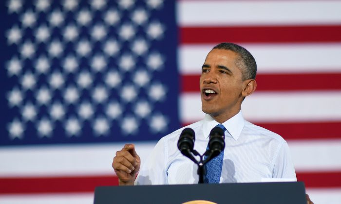 President Barack Obama will propose a $320 tax hike meant to combat economic inequality at his State of the Union Address on Tuesday. He spoke about raising the minimum wage at the University of Michigan in Ann Arbor on April 2, 2014. (Jewel Ssmad/AFP/Getty Images)
