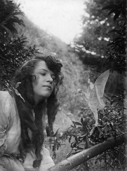 """The fourth photograph, """"Fairy Offering Posy of Harebells to Elsie."""" (Public Domain)"""