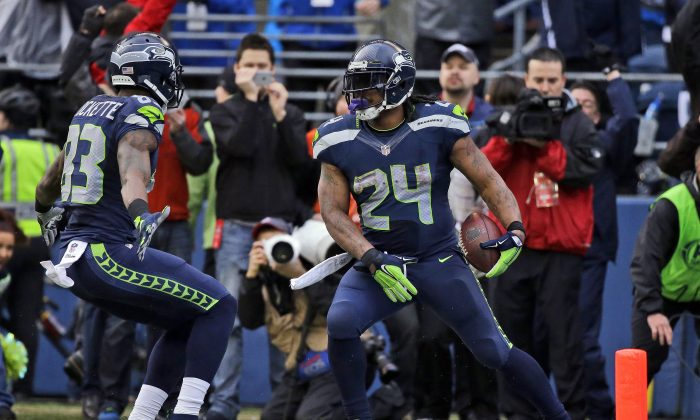 Seattle Seahawks' Marshawn Lynch (24) celebrates his touchdown run during the second half of the NFL football NFC Championship game against the Green Bay Packers Sunday, Jan. 18, 2015, in Seattle. (AP Photo/Elaine Thompson)