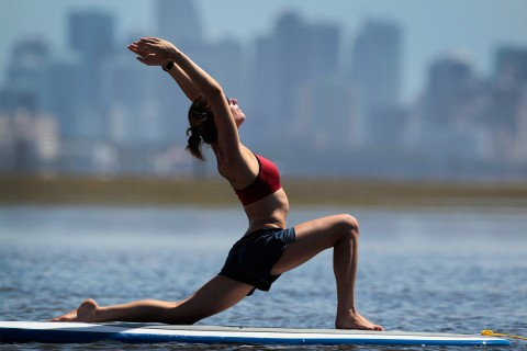 Yoga instructor Sarah Henry leads a class during a paddleboard yoga session (Joe Raedle/Getty Images)