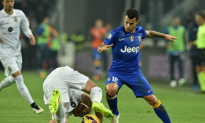Sebastian Giovinco (R) tackles Frederik Sorensen during an Italian Cup match between Juventus and Hellas Verona on Jan. 15 in Turin, Italy. Giovinco is Toronto FC's latest big-name signing after the announcement on Monday, Jan. 19, 2015 in Toronto from general manager Tim Bezbatchenko. (Valerio Pennicino/Getty Images)