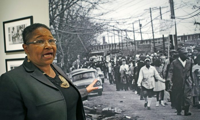 Lynda Blackmon Lowery in front of a Stephen Somerstein photograph showing the 1965 march from Selma to Montgomery, Ala., during a pre-Martin Luther King Day appearance at the New-York Historical Society in New York on Sunday, Jan. 18, 2015. (AP Photo/Kathy Willens)