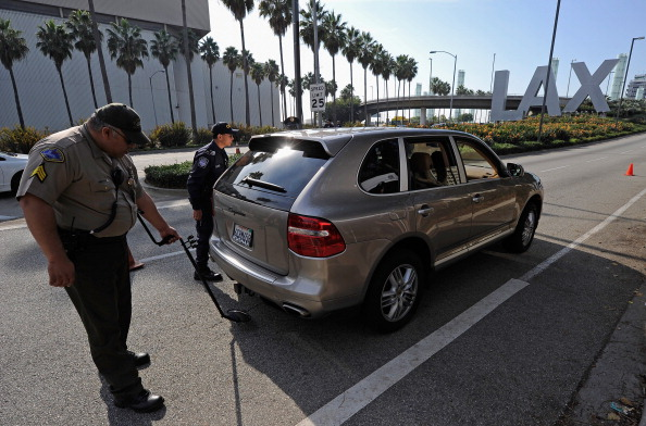 Police officers inspect a car at a security check point at Los Angeles International Airport on November 23, 2011 in Los Angeles, California. Orbitz named LAX as the nation's busiest airport for 2011 Thanksgiving travel.  (Photo by Kevork Djansezian/Getty Images)