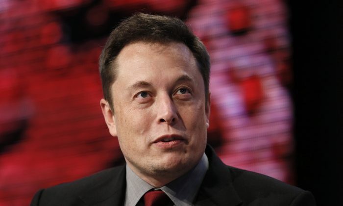 Elon Musk, Tesla Chairman, Product Architect and CEO, speaks at the Automotive News World Congress in Detroit, Jan. 13, 2015. (AP Photo/Paul Sancya)