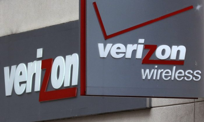 A Verizon Wireless retail store at Downtown Crossing in Boston on June 4, 2014. Verizon launched a loyalty program in June 2014. To earn points for spending, subscribers had to consent to have their movements tracked to help the company target ads. (AP Photo/Charles Krupa)