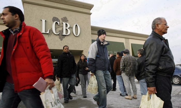 Patrons line up to get into a Mississauga LCBO outlet as others leave after stocking up on their New Year's Eve beverages on Dec. 31, 2007. One of Canada's first Dry January campaigns took place this year as a way to raise money for the Canadian Diabetes Association while balancing out holiday indulgence. (The Canadian Press/J.P. Moczulski)