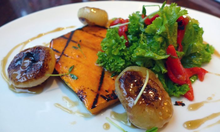 Grilled Bourbon-Maple-Glazed Butternut Squash with Roasted Cipollini Onions and Mustard Greens. (Courtesy of Rock Center Café)