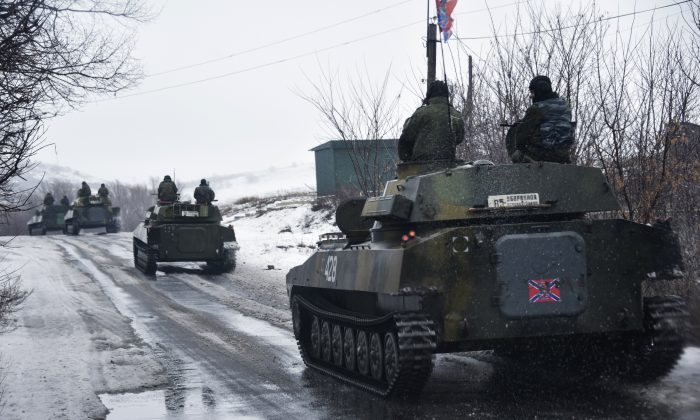 A pro-Russian armored vehicle moves toward Slovyanoserbsk, eastern Ukraine, Wednesday, Jan. 21, 2015. Moscow has proposed restoring a previously agreed line of division in eastern Ukraine to end an escalation of fighting near Donetsk, and has secured rebel agreement to pull back heavy weapons behind it, Russian foreign minister said Wednesday. (AP Photo/Mstyslav Chernov)