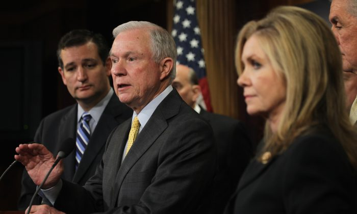 U.S. Sen. Jeff Sessions (R-Ala.) (2nd L) speaks as Sen. Ted Cruz (R-Texas.) (L), and Rep. Marsha Blackburn (R-Tenn.) (R) at a news conference Sept. 9, 2014, on Capitol Hill in Washington, DC. Sessions, a stalwart opponent of immigration reform, is expected to take over as chair of the Senate sub-committee on immigration. (Alex Wong/Getty Images)