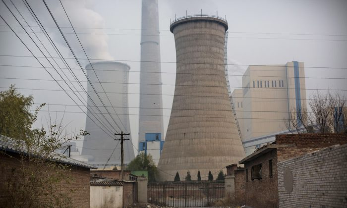 Smoke billows from a coal-fired power plant in Beijing, China on Nov. 19. 2014. (Kevin Frayer/Getty Images)