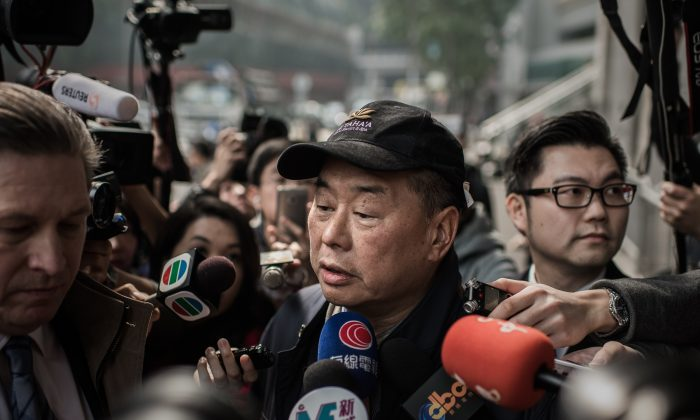 Outspoken media tycoon Jimmy Lai talks to the media after walking out of the Wanchai police station in Hong Kong on Jan. 21, 2015. (Philippe Lopez/AFP/Getty Images)