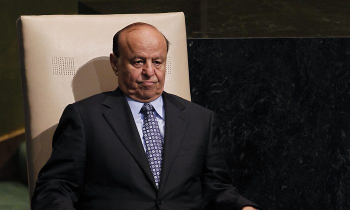 """Abed Rabbo Mansour Hadi, President of Yemen, sits after addressing the 67th session of the United Nations General Assembly at U.N. headquarters on Sept. 26, 2012. Two of the Yemeni embattled president's advisers said that the president is held """"captive"""" in hands of Houthis and warned if submitted resignation in protest to Houthis' power grab, to face prosecution. (AP Photo/Jason DeCrow)"""