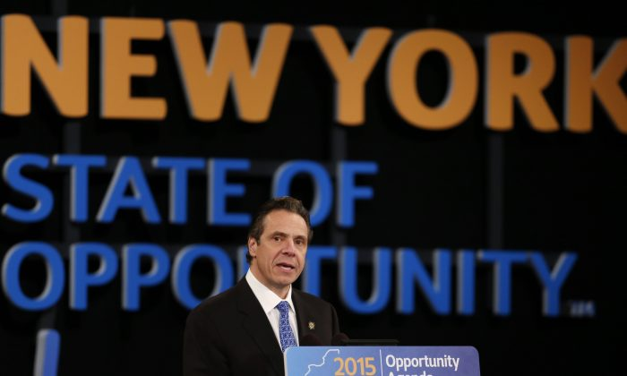 New York Gov. Andrew Cuomo delivers his State of the State address and executive budget proposal at the Empire State Plaza Convention Center on Wednesday, Jan. 21, 2015, in Albany, N.Y. He outlined several proposals to restore public trust in the criminal justice system, following police-involved fatalities in Ferguson, Mo. and Staten Island, New York City. (AP Photo/Mike Groll)